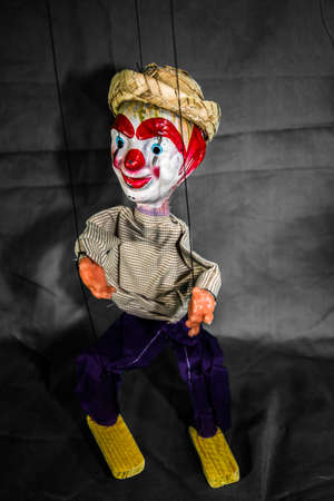 Mexican Marionette Puppet On Grey. A Mexican marionette puppet against a grey background. Stock Photo