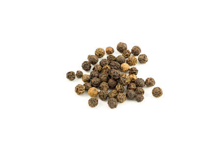 piperine: Peppercorns 1. Dried black peppercorns isolated on white.
