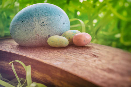 soft colors: Easter Eggs. Holiday Easter eggs and grass with soft pastels colors and lighting. Some vintage filters added.
