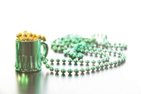 saint patty's: St Patricks Day Mini Green Mug Gold Beads. A small novelty green mug necklace with gold beads. In the style of St Patricks Day.