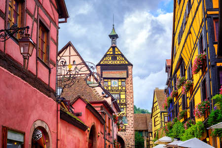 colmar: Colorful houses on a central street in Riquewihr, village on wine route in Alsace, France Editorial