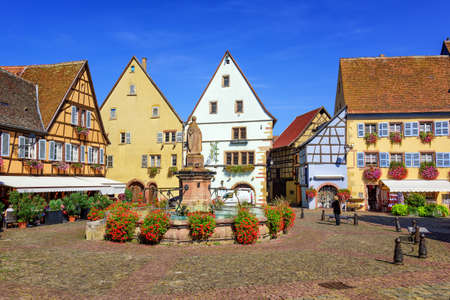 little town: Colorful half-timbered houses in Eguisheim, Alsace, France