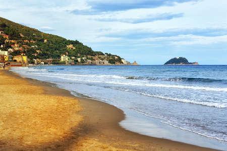 sanremo: Sand beach on the mediterranean coast of italian Riviera by Imperia, Italy Stock Photo