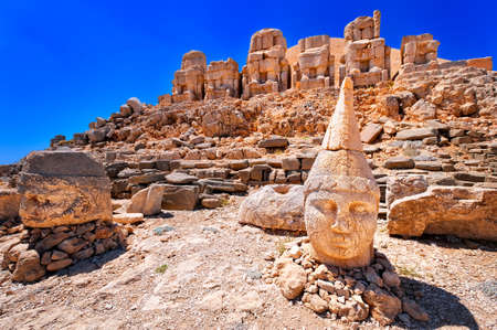 Antique statues on the top of Nemrut mountain at sunrise, Turkey