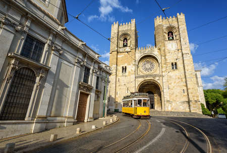 electric tram: Old tram in front of cathedral in Lisbon, Portugal
