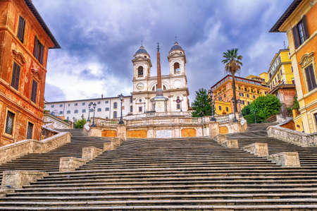 trinita: Spanish Steps and Trinita dei Monti church, a famous tourist destination in Rome, Italy Stock Photo