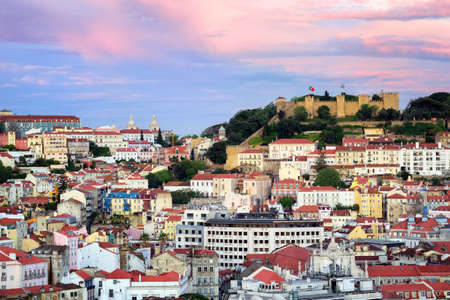 portugal: Lisbon, Portugal, view to the Alfama quarter and St. Jorge Castle at sunset Stock Photo