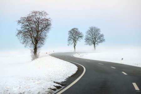 winter day: Winding winter road Stock Photo