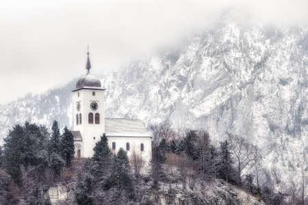 cristian: Cristian church on a snow covered hill in winter near Salzburg, Austria