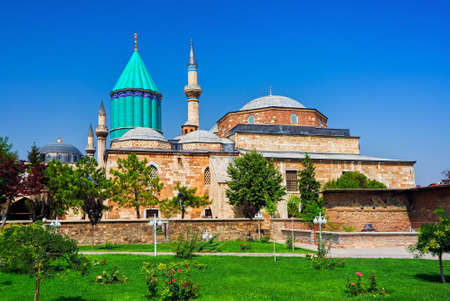 Tomb of Mevlana, the founder of Mevlevi sufi dervish order, with prominent green tower in Konya, Turkey