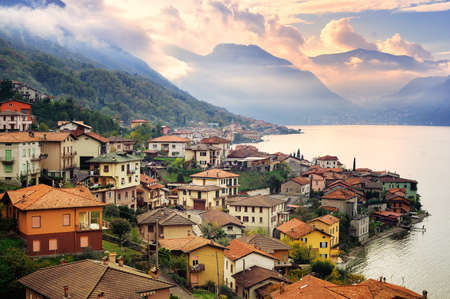 View of Como Lake, Milan, Italy, on sunset with Alps mountains in background Imagens