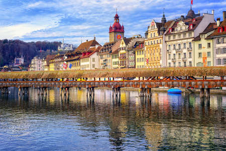 Lucerne, Switzerland, view over Reuss river to the old town and wooden Chapel bridge