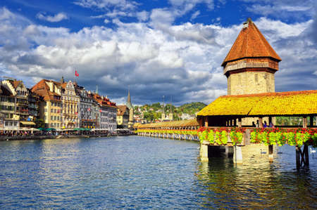 water town: Lucerne, Switzerland, river and the old town with wooden Chapel Bridge and Water tower