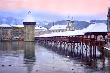 Lucerne, Switzerland, Chapel bridge, Water tower and Jesuit church on a winter evening