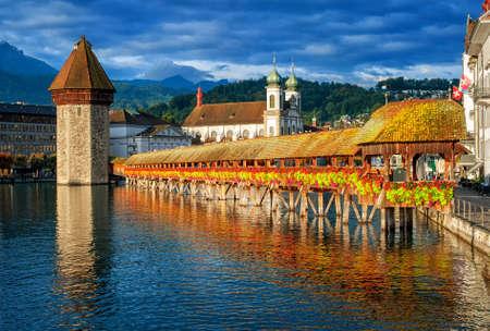 Lucerne, Switzerland, Chapel Bridge, Water Tower, Jesuit Church skyline on sunrise