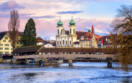 lucerne: Lucerne, Switzerland, view over the Reuss river to the wooden Spreuer Bridge, Jesuit Church and the Old Town Stock Photo