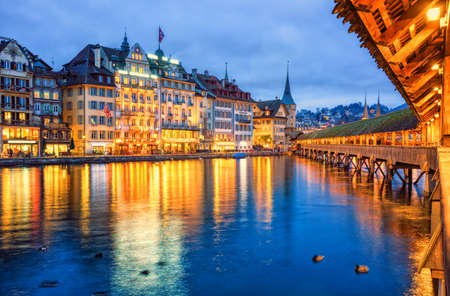 lucerne: Lucerne, Switzerland, view of the old town from wooden Chapel bridge in the evening