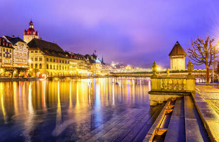 Lucerne, Switzerland. View over Reuss river to the old town and Water tower in the evening.