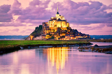 Mont Saint-Michel is one of Frances most recognizable landmarks, listed on UNESCO list of World Heritage Sites. Stock Photo