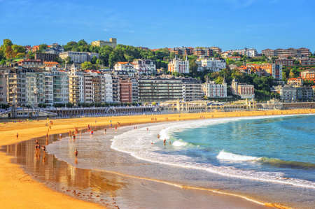 the bay: Sand beach in the town center of San Sebastian in Bay of Biscay, Spain Stock Photo