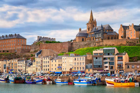 Gothic church on the hill and fishermen boats in port town Granville, Normandy, France