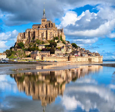 fortress: Mont Saint-Michel is one of Frances most recognizable landmarks, listed on UNESCO list of World Heritage Sites. Stock Photo