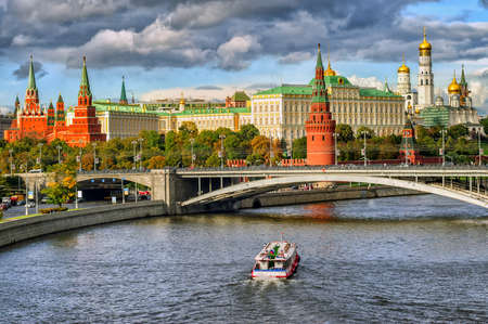 Red and white towers of Moscow Kremlin over Moskva river, Moscow, Russia
