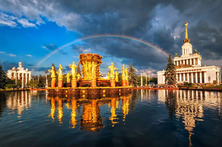 neo classical: Rainbow over golden fountain and neo classical pavillon at the National Exhibition Center, Moscow, Russia Stock Photo
