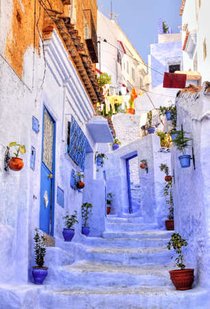 Street with stairs in medina of moroccan blue town Chefchaouen