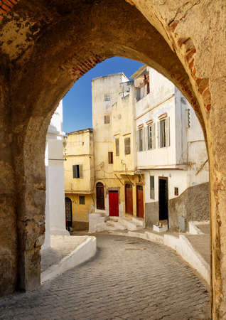 gibraltar: View to a narrow street through the city gate in Tangier, Morocco Stock Photo