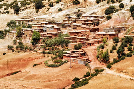 bedouin: Red clay stone bedouin village in Atlas mountains, Sahara, Morocco