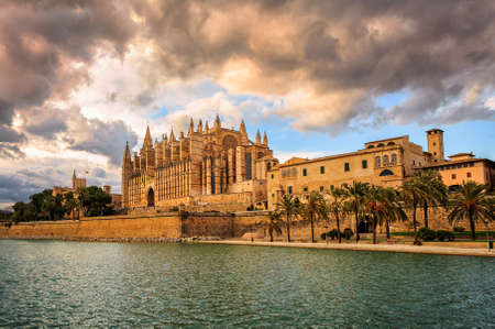 Sunset over medieval gothic La Seu, the cathedral of Palma de Mallorca, Spain