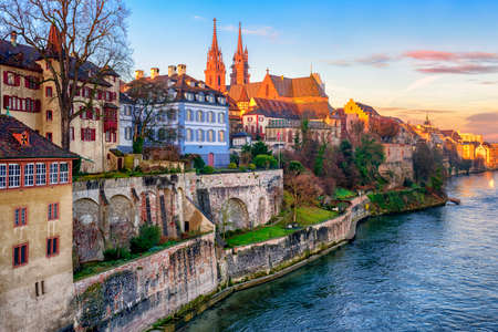 river       water: Old town of Basel with red stone Munster cathedral on the Rhine river, Switzerland Stock Photo