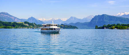 lucerne: Cruise ship in front of snow covered Alps mountains peaks on Lake Lucerne, central Switzerland Stock Photo