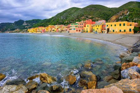 Colorful fishermans houses on the sand beach lagoon on italian Riviera in Varigotti, Savona, Liguria, Italy