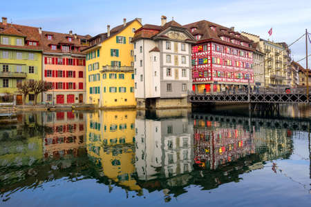 water town: Historic buildings reflecting in the water, old town of Lucerne, Switzerland