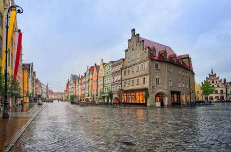 landshut: Old gothic street in bavarian town Landshut near Munich, Germany on a rainy day Stock Photo