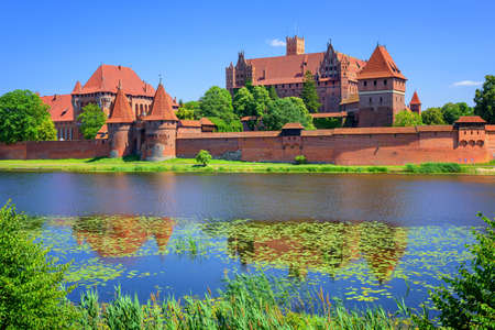 gothic castle: The Castle of the Teutonic Knights Order in Malbork, Poland, historical Prussia, is the largest castle in the world