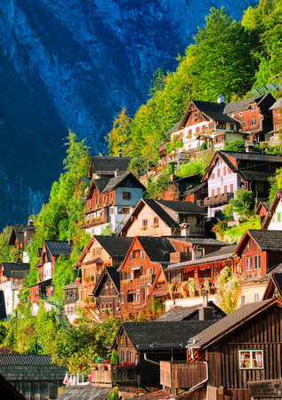 austrian village: Traditional wooden houses on the mountain slope in Hallstatt, Austria