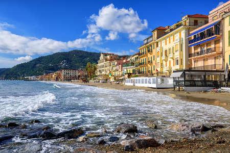 Mediterranean beach promenade in traditional touristic town Alassio on italian Riviera by San Remo, Liguria, Italy Banco de Imagens