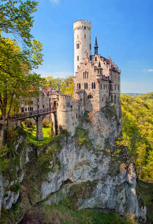 Romantic Lichtenstein castle with fancy decorated towers sitting on a rock in Black Forest, Wurttemberg, Germany Stock Photo