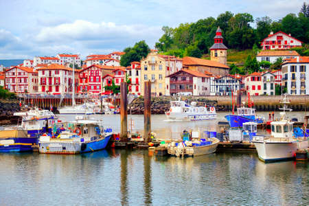 Traditional half-timbered basque houses in port of St Jean de Luz, on the atlantic coast of France Standard-Bild