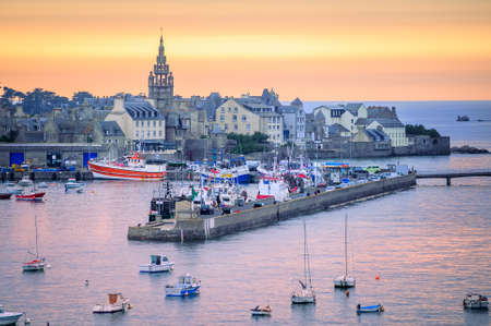 Sunset over the port of Roscoff, a popular tourist destination in Finistere departement of Brittany in northwestern France 写真素材