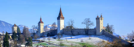 lucerne: Panoramic view of the medieval city wall and guard towers in Lucerne, Switzerland, on a sunny winter day