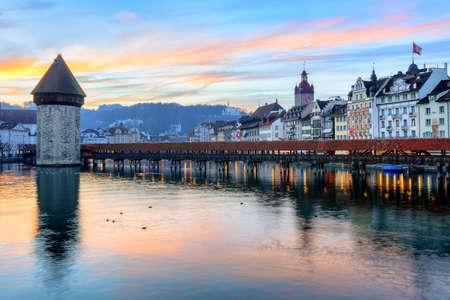 water town: Old town of Lucerne reflecting in the water of Reuss river on sunset, Lucerne, Switzerland Stock Photo