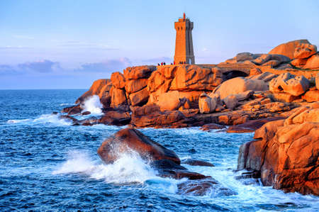 ploumanac'h: Lighthouse of Ploumanach Mean Ruz in Perros-Guirec on Pink Granite Coast, Brittany, France, on sunset