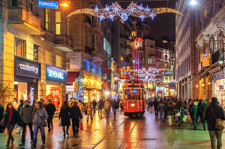 electric avenue: ISTANBUL, TURKEY - February 22: Nostalgic tramway on the main pedestrian Taksim Istiklal Street at late evening on February 22, 2015 in Istanbul, Turkey Editorial