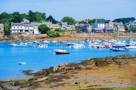 granit: Yachts in a bay of Tregastel town on Cote de Granit Rose, Atlantic ocean, Brittany, France Stock Photo