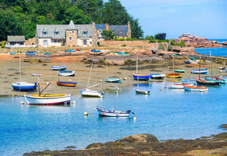 cote de granit rose: Colorful fishermens boats on the tidal beach on Cote de Granit Rose, Atlantic ocean, Brittany, France