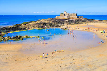swimm: Sand beach by the National Fort in St Malo on atlantic Emerald Coast, Brittany, France